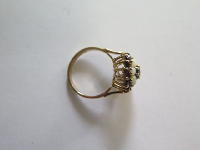 A hallmarked 9ct yellow gold opal and sapphire cluster ring, head 15mm wide, ring size O, approx 3.7 - Image 3 of 3