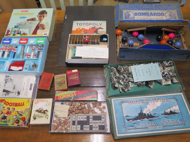 A selection of board and other games and a Chemistry set
