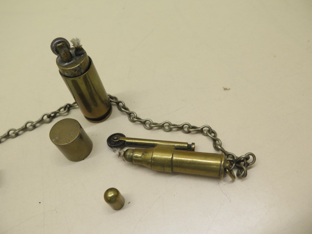 Two trench lighters and a dented Metropolitan whistle - Image 3 of 3