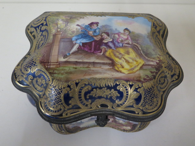 A continental hand decorated shaped porcelain trinket casket with serves style mark, 11cm tall x