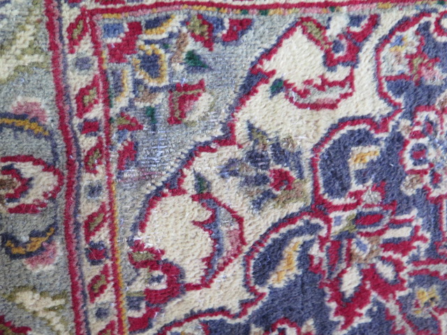 A rich red ground hand woven woollen full pile Persian Kashan carpet with traditional floral - Image 5 of 8