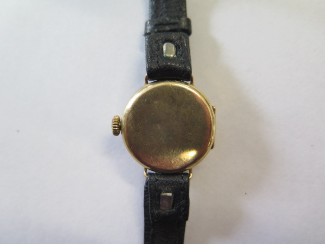 A 9ct yellow gold manual wind wristwatch on leather strap, 2cm wide, not working, total weight - Image 3 of 3