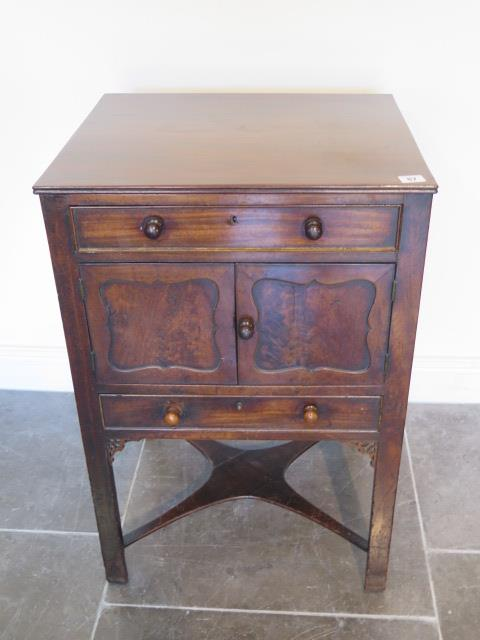A Georgian and later mahogany wash stand with two drawers and two cupboard doors, 79cm tall x 52cm x