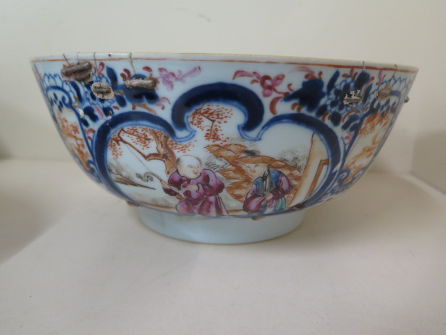 A 19th century famille rose bowl, diameter 23cm x 10cm tall, multiple repairs and chips but