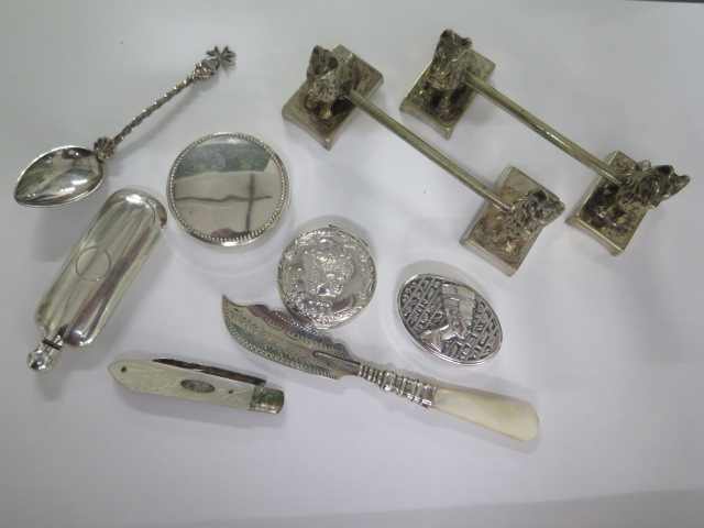 Three small silver pill boxes, a plated scent bottle, a penknife, spoon, mother of pearl and