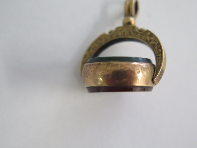 A 9ct yellow gold swivel fob marked 9 375 in generally good condition, approx 5.4 grams, 22mm wide - Image 3 of 4