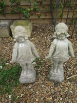 A pair of stone effect statues, 62cm tall