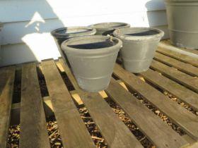 Four small grey frost proof plant pots 30 cm diameter