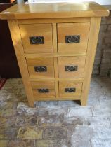 A modern Oak six drawer chest 94 cm tall 67 by 40