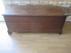 A 19th century oak coffer storage box with an internal candle box with a well figured top, 51cm tall