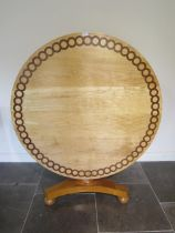 A new 19th century style yew and oak inlaid maple circular tilt top breakfast table made by a