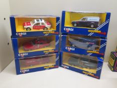 Two boxed Noturzt and Notruf Corgi cars and a van and three other vehicles all boxed, boxes have
