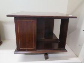 An Edwardian mahogany inlaid table top revolving bookshelf, 33cm tall x 39cm x 39cm, in generally