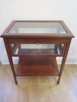 An Edwardian inlaid mahogany bijouterie display table with a drop down door, in generally good