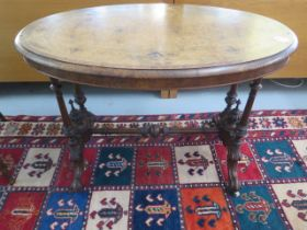A Victorian inlaid stretcher table on turned pillar supports, 70cm tall x 99cm x 55cm, some losses