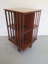 A mahogany revolving bookcase, 73cm tall x 41cm x 41cm, in generally good condition