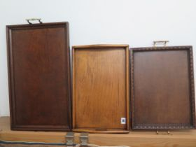 Three Edwardian oak tea trays, largest 60cm x 34cm, in good polished condition