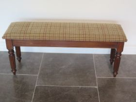 A new mahogany upholstered 19th century style window seat made by a local craftsman to a high