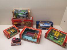 Five boxed Britains Ltd farm implements and tractor, a boxed Corgi Gas Escort van and a Matchbox