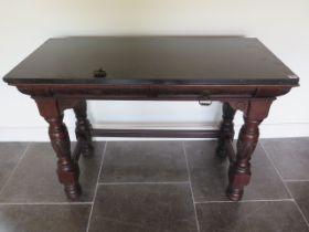 A Victorian black slate top mahogany serving table with two frieze drawers, one stamped Gillows