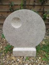 A hand carved abstract garden sculpture, circular design with sparrow pecking detail, 54cm tall x