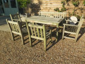 A Barlow Tyrie garden table , bench and four armchairs in nicely weathered condition , table 70 cm