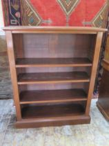 An early 20th century mahogany bookcase with three adjustable shelves, 112cm tall x 92cm x 29cm,