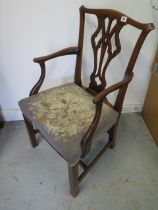 A Georgian mahogany chair with later yew wood arms with a overstuffed needdlepoint seat, 93cm tall x