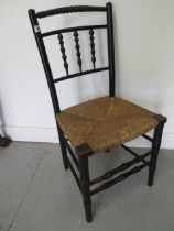 A 19th century William Morris style Sussex Chair, 87cm tall