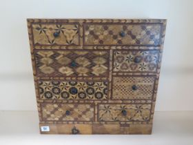 An Oriental parquetry inlaid eight drawer jewellery / collectors chest, 45cm tall x 45cm x 17cm,