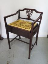 An Edwardian mahogany box seat piano stool with recovered seat in polished condition