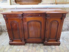 A good quality mahogany breakfront sideboard with two frieze drawers and three cupboard doors