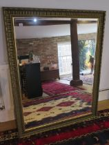 A large gilt framed modern mirror, 137cm x 107cm, in good condition