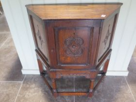 A carved oak cupboard with a single door, back panel missing, 79cm wide