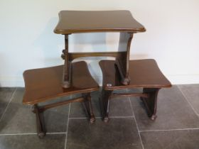 A set of three mahogany tables one with a carved rat, 44cm tall x 53cm x 40cm, all generally good