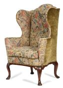 A GEORGE I WALNUT WING ARMCHAIR C.1725 later upholstered with 18th century style gros point