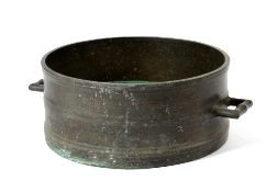 A BRONZE BUSHEL MEASURE PROBABLY EARLY 18TH CENTURY the moulded body with a pair of angular lug