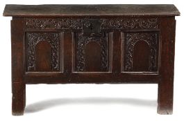 A CHARLES II BOARDED OAK COFFER C.1660 of six plank construction, the later hinged top with a