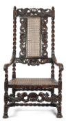 A WALNUT OPEN ARMCHAIR IN WILLIAM AND MARY STYLE 19TH CENTURY carved with crowns, shells and