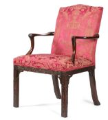 A GEORGE III MAHOGANY OPEN ARMCHAIR C.1770 with an arched padded back and seat, covered with
