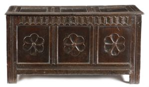 AN OAK TRIPLE PANELLED COFFER WEST COUNTRY, MID-17TH CENTURY the hinged top revealing a vacant
