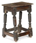 A 17TH CENTURY OAK JOINT STOOL C.1620-40 the seat with a moulded edge, above a moulded rail and on
