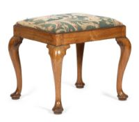 A GEORGE II WALNUT STOOL C.1730-40 with a later needlework drop-in seat, on cabriole legs and pad