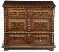 A WILLIAM AND MARY OAK CHEST C.1690 the top with a moulded edge, above three long drawers with