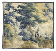 A FLEMISH VERDURE TAPESTRY 17TH CENTURY worked with trees and with a castle in the distance 226.8