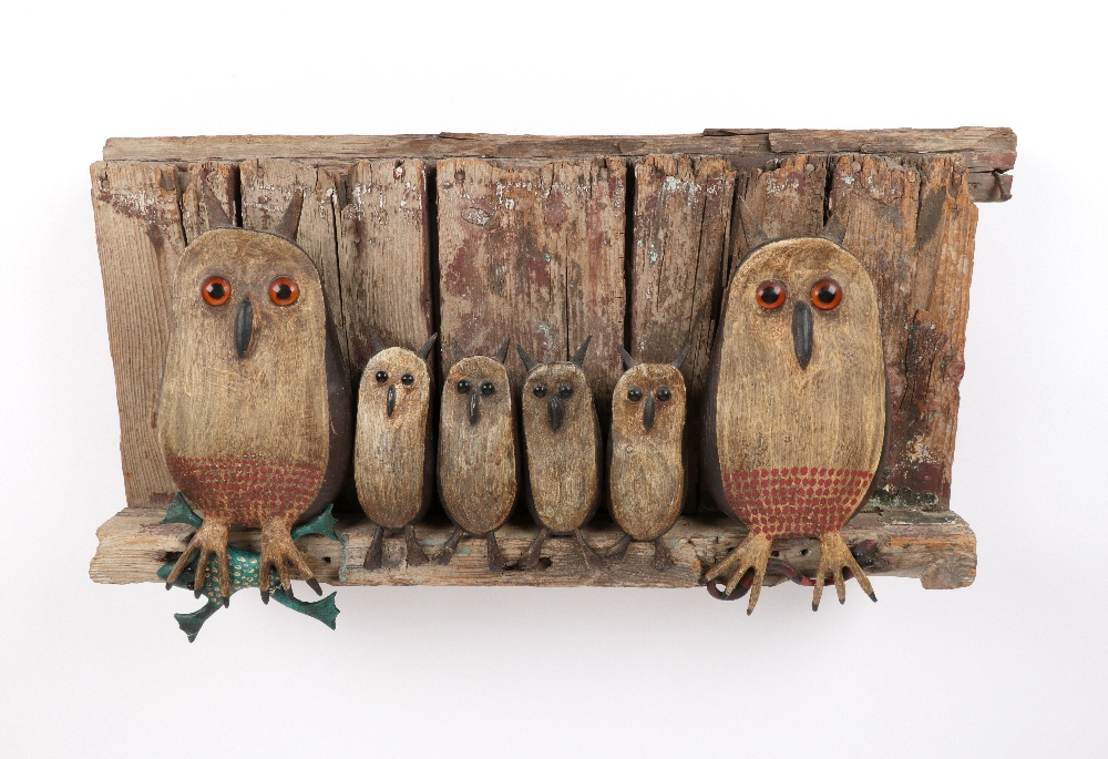 ‡Guy Taplin (b.1939) Owl family with frog and worm Painted driftwood with glass bead eyes 35 x 64.