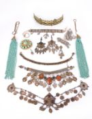 A collection of Berber jewellery Morocco including a gilt brass headdress with applied florets and