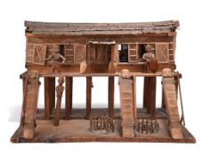 A Dayak model longhouse Borneo, Indonesia fibre and wood, the stilted structure with doors and