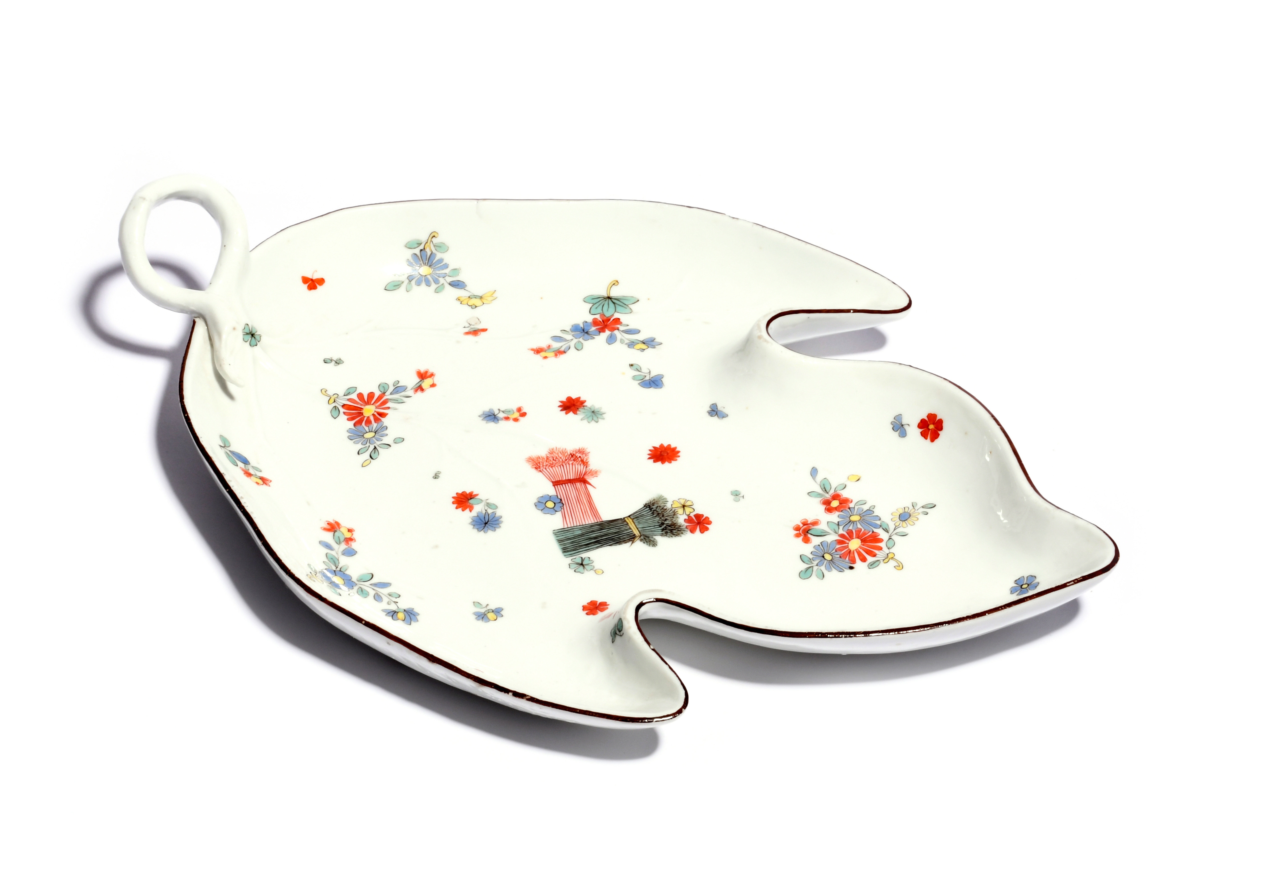 A large Meissen leaf-shaped dish c.1735-40, painted in the Kakiemon palette with banded sheaves