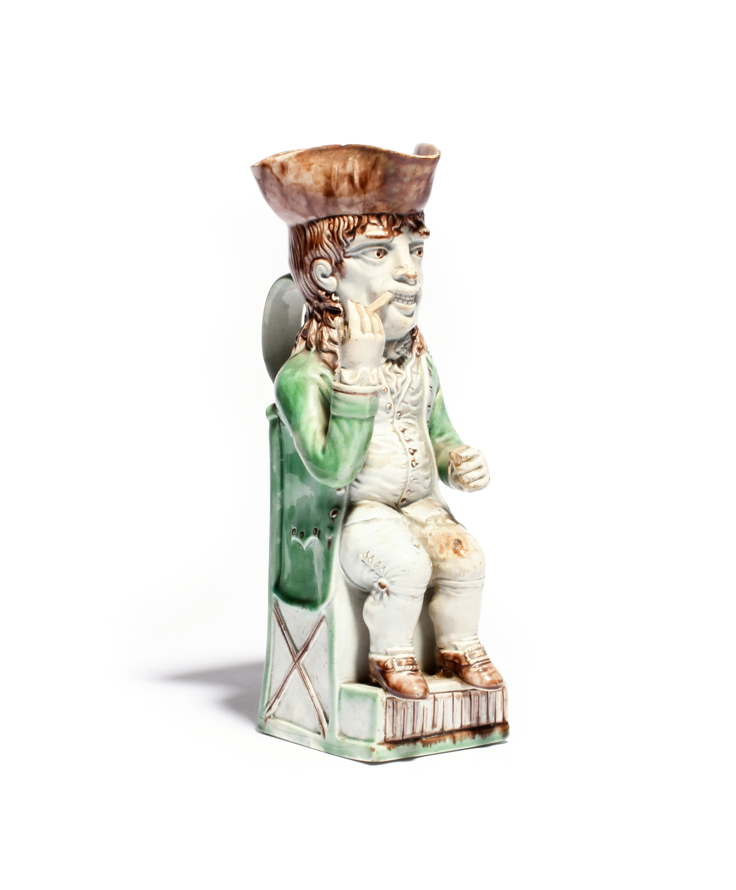 A Wood family Thin Man Toby jug c.1780, crisply modelled and seated on a stepped base, holding the